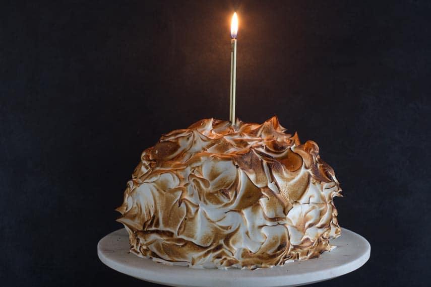 low FODMAP lemon meringue cake with candle