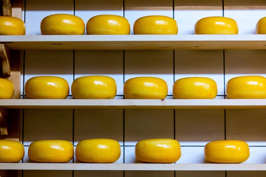 wheels of cheese, aging