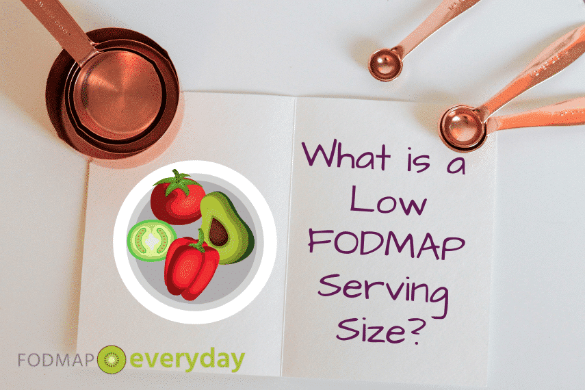 "Booklet with text ""what is a Low FODMAP serving size"" with rose gold measuring cups on top"