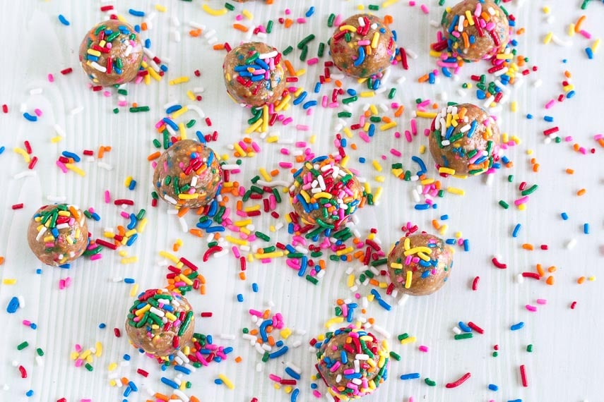 overhead view of Low FODMAP Birthday Cake Bliss Balls with sprinkles all over