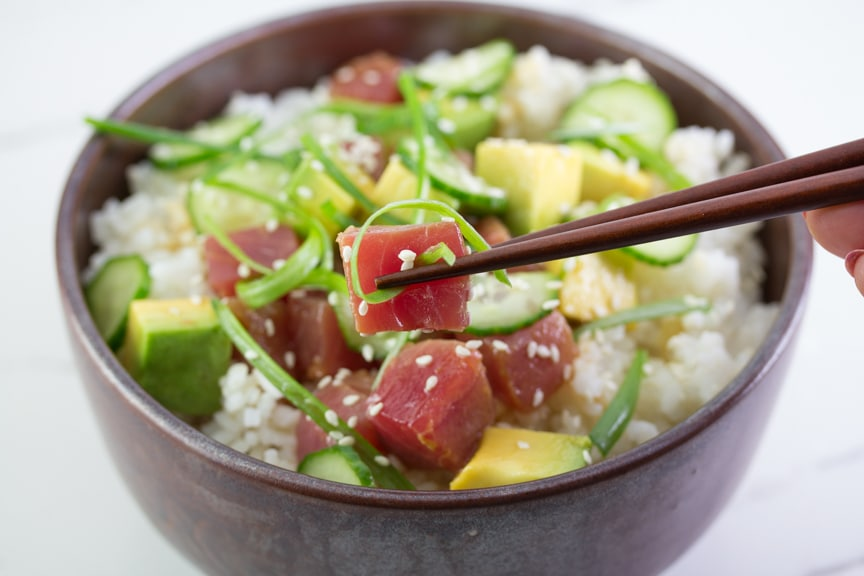 closeup of low FODMAP tuna poke in brown bowl with chopsticks