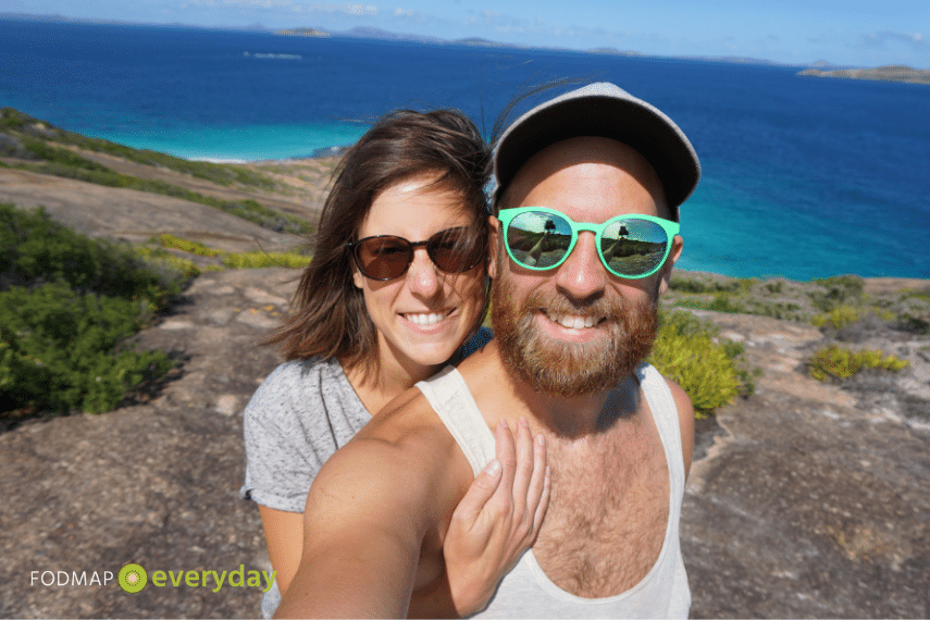A selfie picture of Angi and her boyfriend Pam with the ocean behind them.