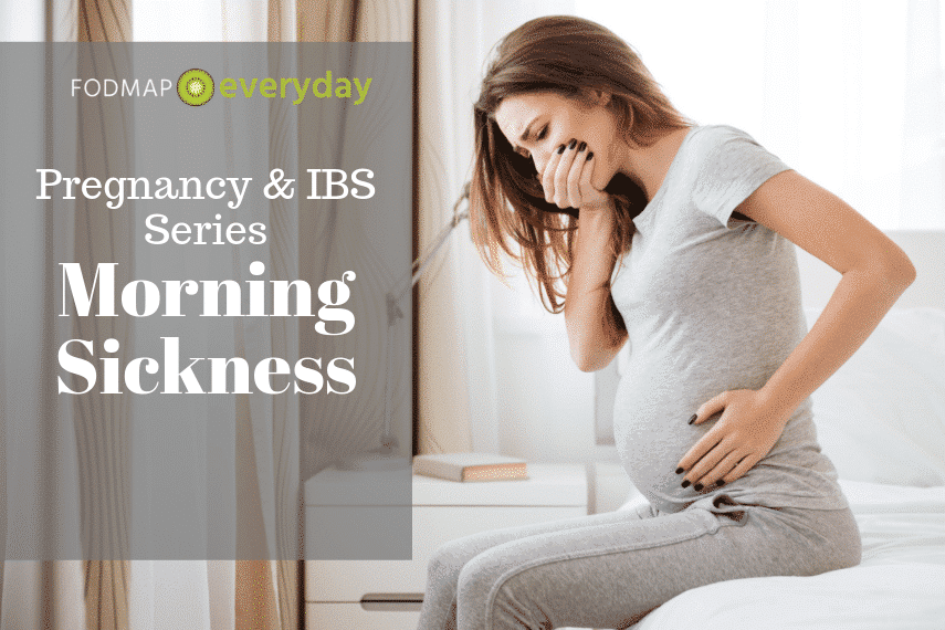 Pregnant woman sitting on the edge of a bed holding her belly with one hand and her other over her mouth - dealing with morning sickness.
