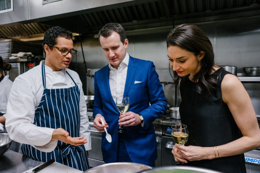 Chef Daniel Chavez-Bello discussing a dish with Epicured's co-founders Richard Bennett and Renee Cherkezian in their test kitchen.
