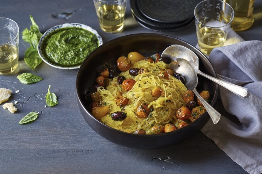 Basil Pesto Spaghetti Squash in a black bowl on a grey table