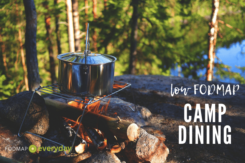 """metal pot on over a campfire in the woods with text reading """"Low FODMAP Camp Dining"""""""
