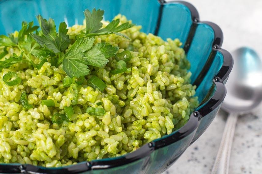 low FODMAP Cilantro Lime Rice in an aqua blue glass bowl; spoon alongside