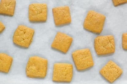 Low FODMAP Cheese Crackers on parchment lined baking sheet pan