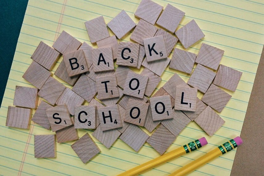"scrabble tiles spelling out ""back to school"""