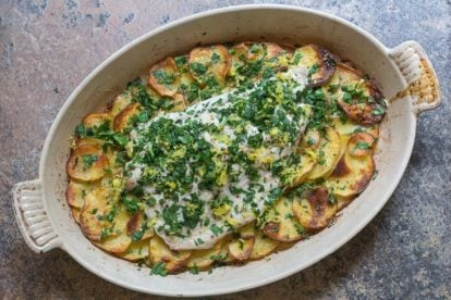 low FODMAP Bluefish with Roasted Garlic Potatoes in an oval casserole dish