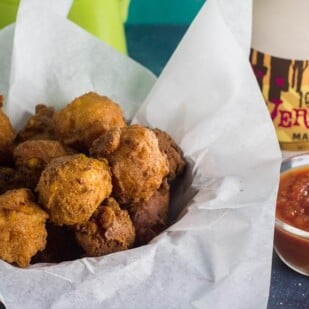 low FODMAP corn fritters with salsa and maple syrup alongside