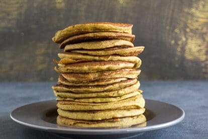 Low FODMAP Buckwheat Banana Pancakes on gray plate and gray surface