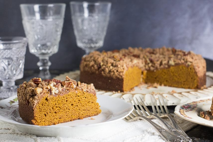 Low FODMAP Pumpkin Gingerbread Streusel Coffee Cake in background; slice on plate in foreground