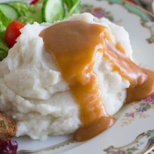 closeup of Low FODMAP vegetarian gravy on mashed potatoes