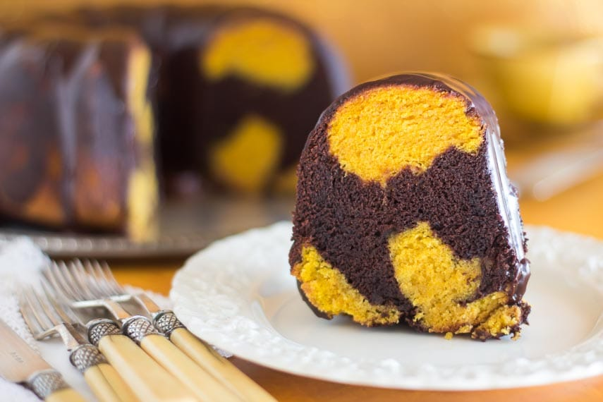 closeup of slice of low FODMAP Pumpkin Chocolate Marble Cake on white plate