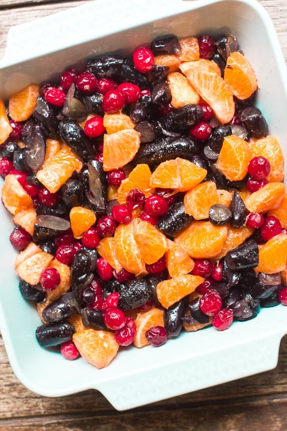 fruit filling for Low FODMAP Cranberry Crisp with Grapes & Citrus in a light blue baking dish
