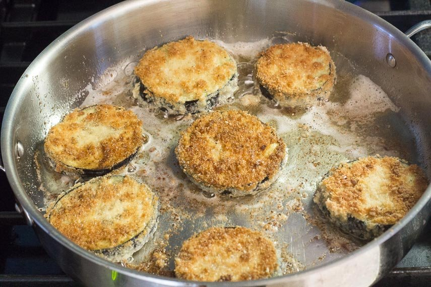 frying eggplant for low FODMAP eggplant parmesan in round skillet