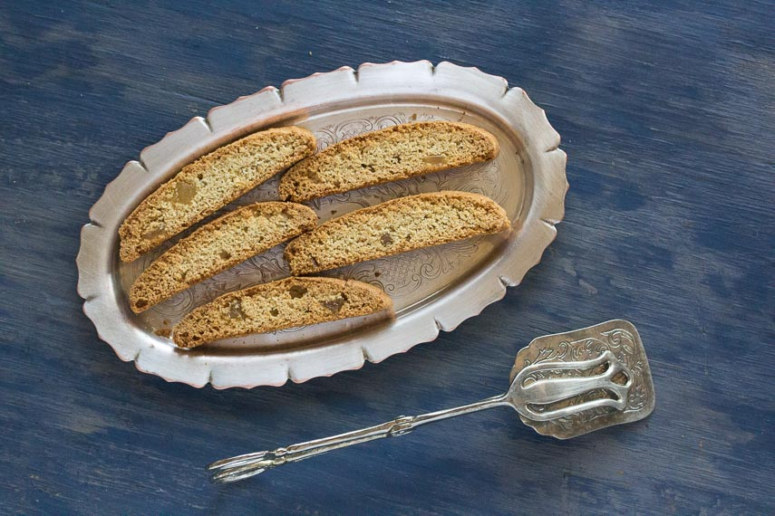 low FODMAP Triple Ginger Biscotti on oval silver platter against blue wood background