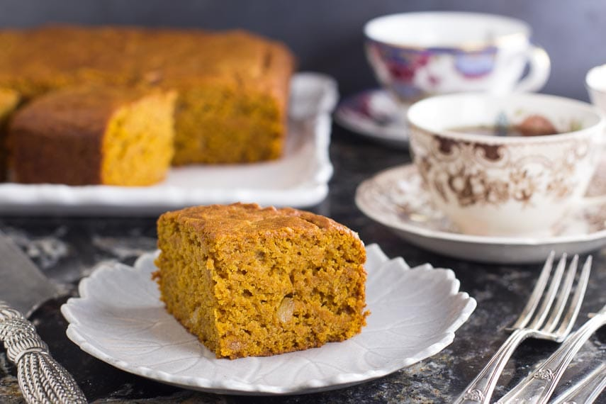 low FODMAP triple ginger pumpkin cake on plate; forks alongside