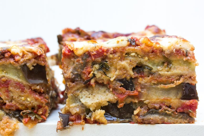 side view of piece of low FODMAP eggplant parmesan; white background