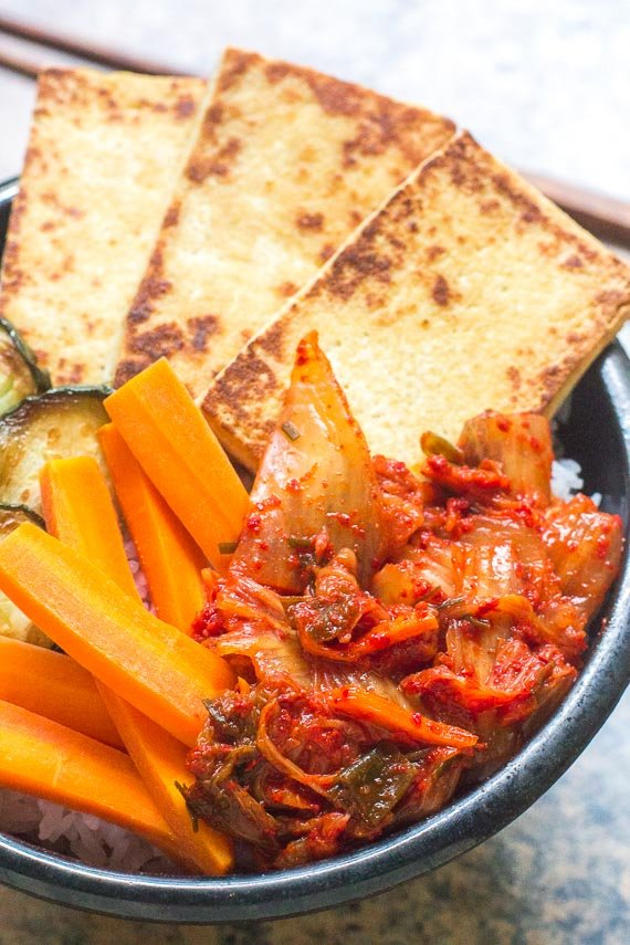 vertical image of bowl of tofu, carrots and low FODMAP kimchi