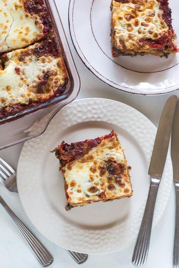vertical image of hearty low FODMAP lasagna on plate in in baking pan