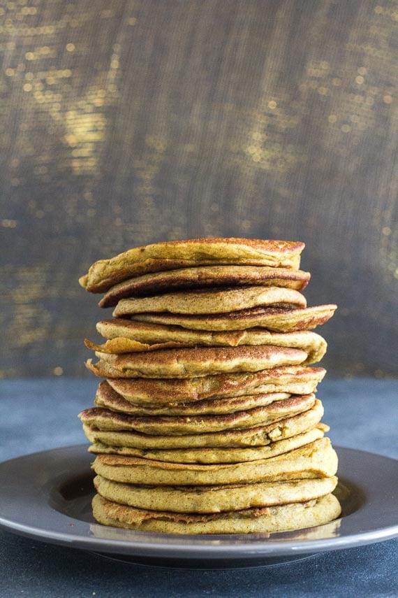vertical image of stack of Low FODMAP Buckwheat Banana Pancakes on gray plate