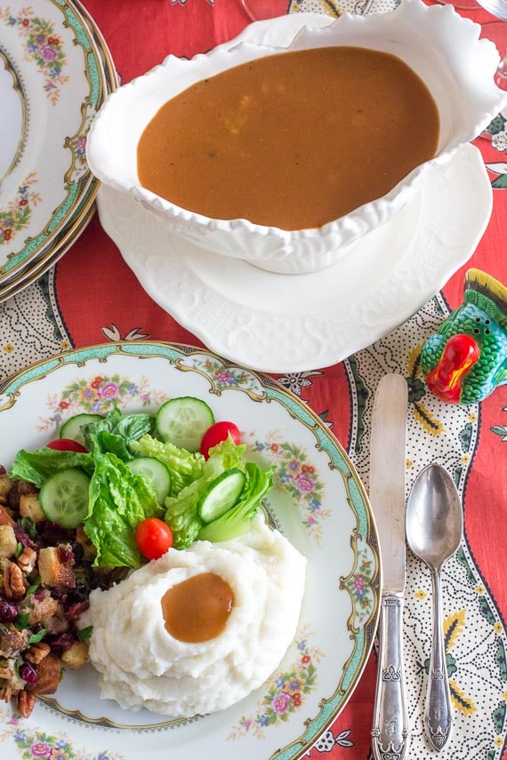 vertical of Low FODMAP vegetarian gravy in gravy boat and on mashed potatoes