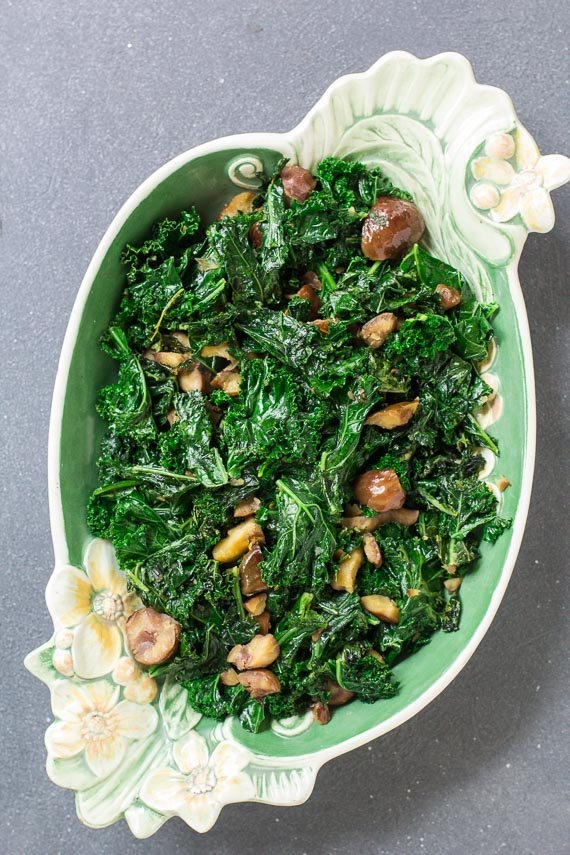 vertical overhead of Garlicky Low FODMAP Sautéed Kale with Chestnuts in oval plate