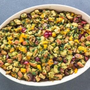 Loaded Low FODMAP Vegetarian Stuffing in oval dish on gray backdrop
