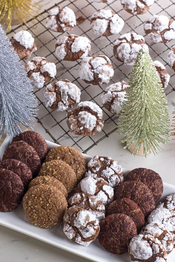 Low FODMAP CHocolate Crinkle Cookies on rack and platter with various toppings