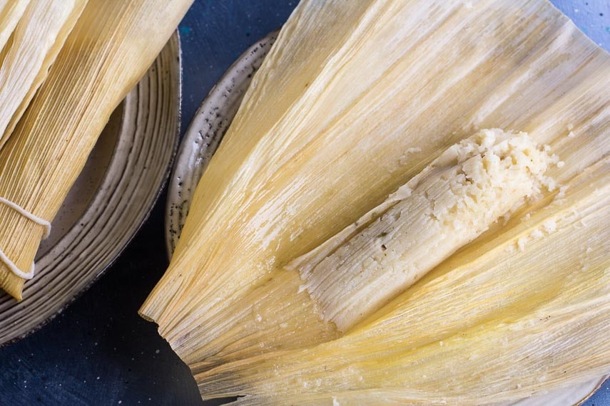 Low FODMAP tamales, unwrapped; Cornhusk underneath