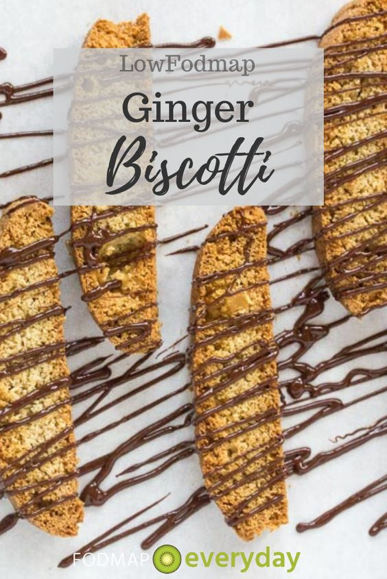 "low FODMAP triple ginger biscotti drizzled with chocolate on parchment lined pan with text overlay reading ""Low FODMAP Ginger Biscotti"""