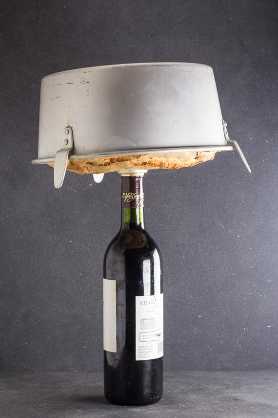 cooling a low FODMAP angel food cake upside down inverted on a wine bottle-2