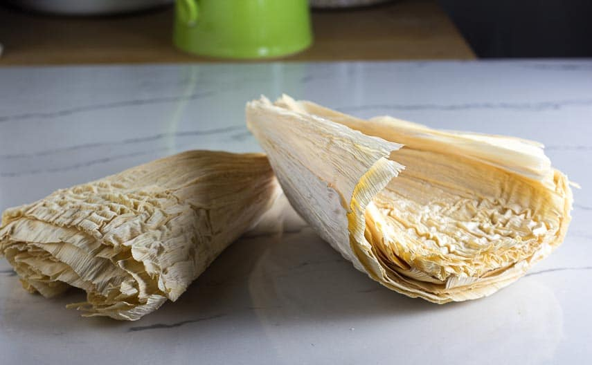 dried cornhusks for tamales on white quartz surface