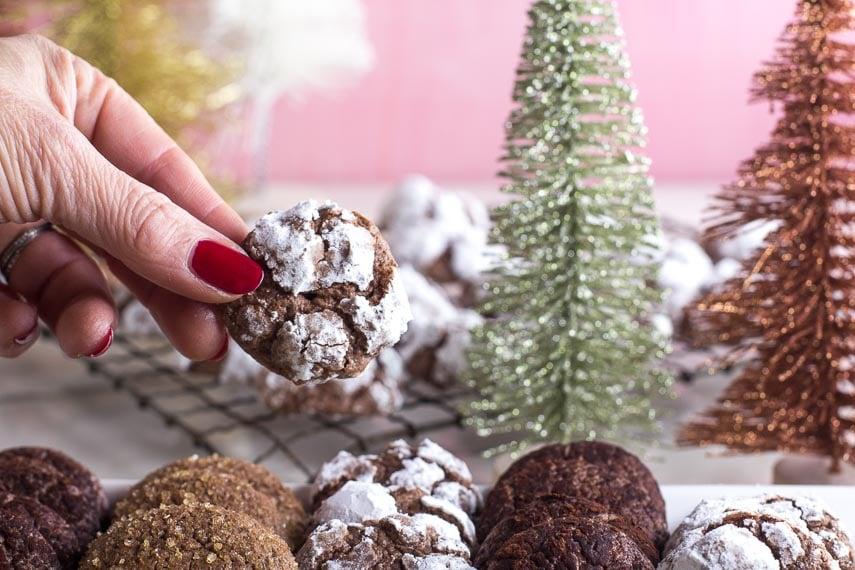 low FODMAP chocolate crinkle cookies in hand