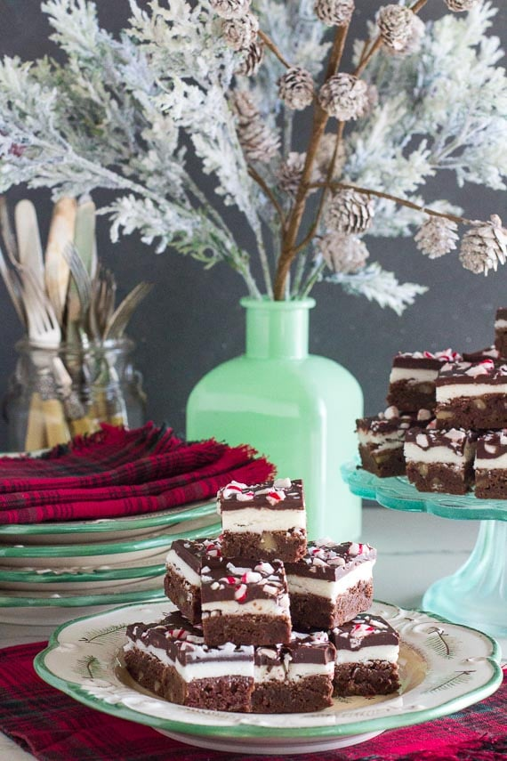 vertical image of Low FODMAP Peppermint brownies on plate, pedestal