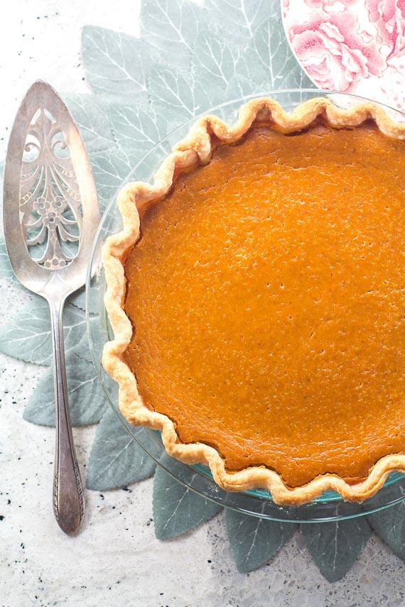vertical low FODMAP classic pumpkin pie with silver serve