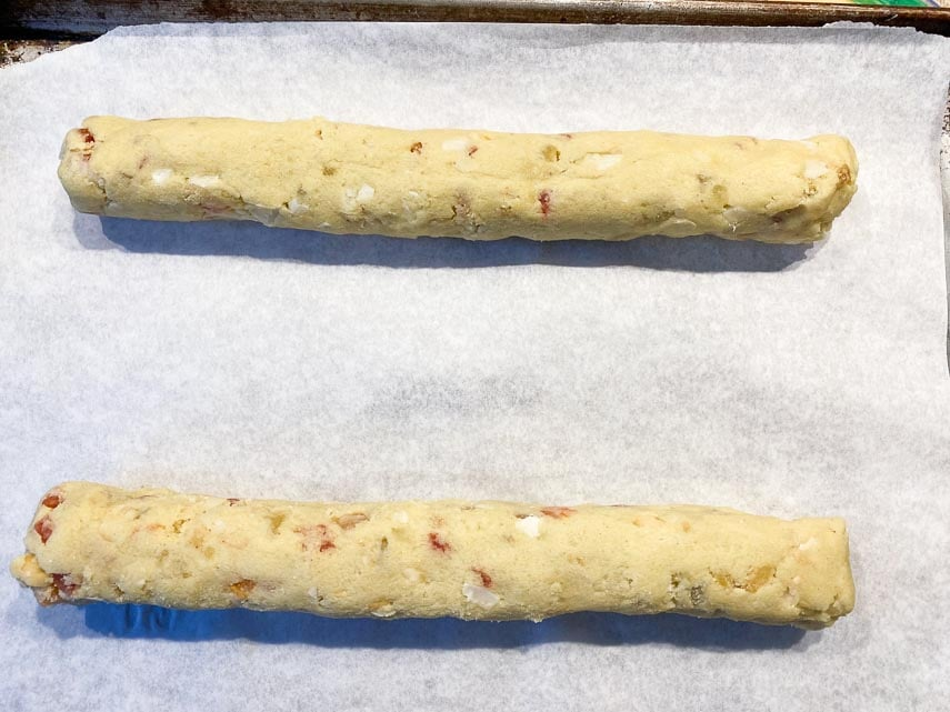 12-inch raw logs of tropical biscotti on sheet pan lined with parchment paper