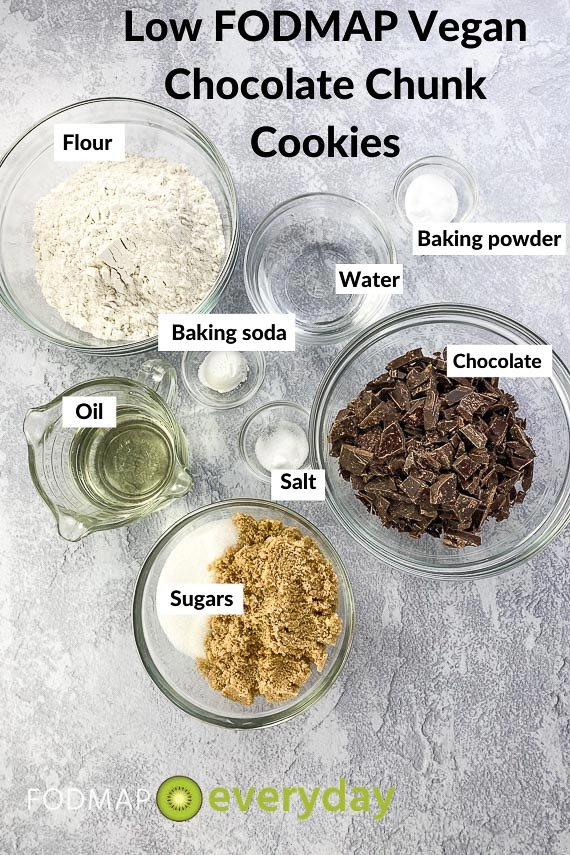 Low FODMAP Vegan Chocolate Chunk Cookies ingredients in glass bowls on grey background