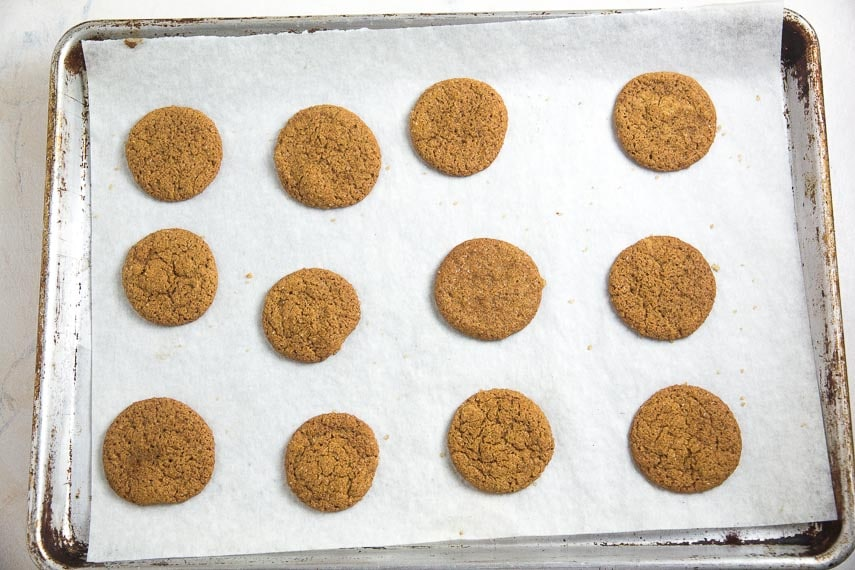 baked low FODMAP gingersnaps on parchment lined baking pan
