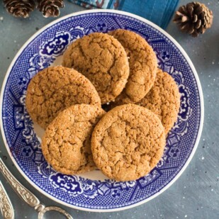 overhead image of low FODMAP gingersnaps on decorative blue plate; blue background