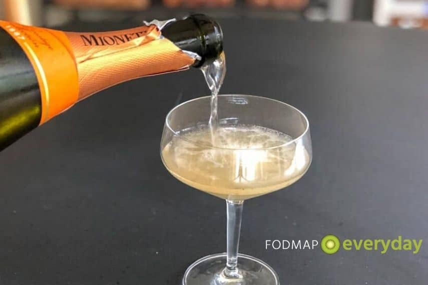 Champagne being poured into a champagne glass