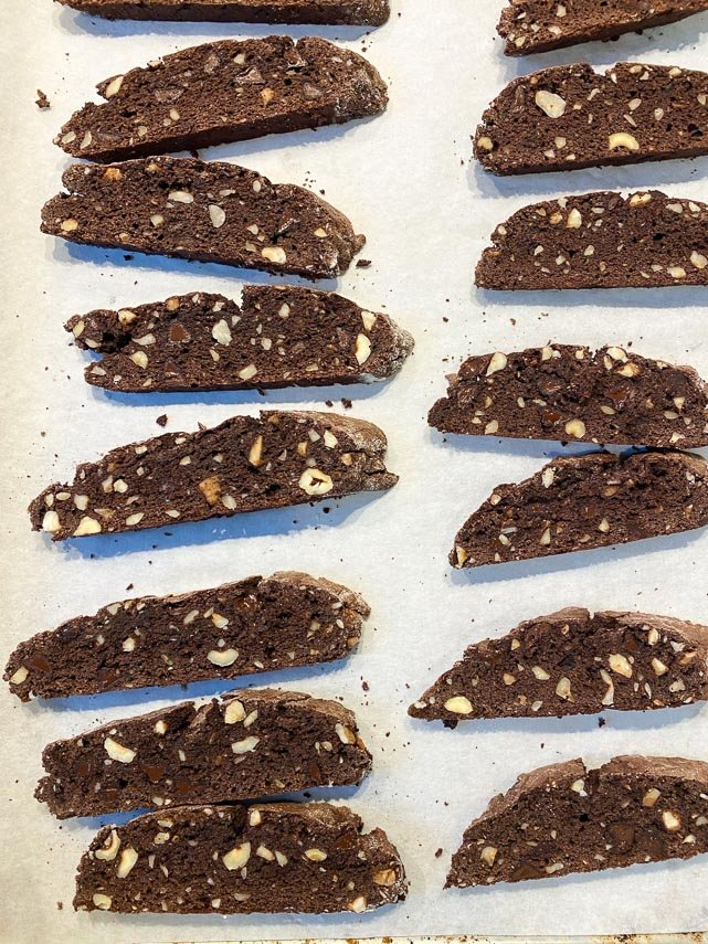 chocolate hazelnut biscotti, after being cut, on pan ready for second baking