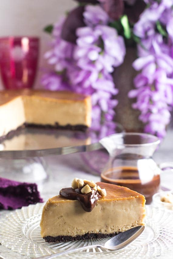 chocolate sauce on top of a slice of frozen low FODMAP peanut butter cheesecake