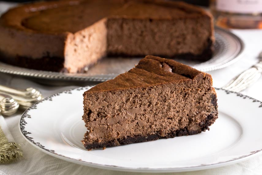 slice of low FODMAP chocolate cheesecake on white plate