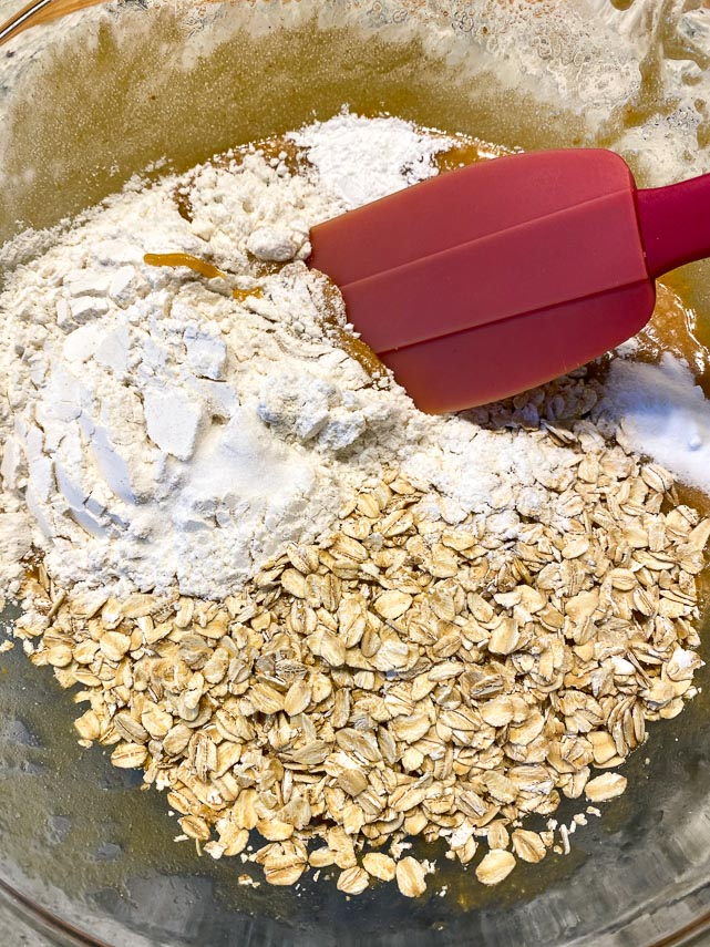 Add the dry ingredients while making one-bowl low FODMAP peanut butter oatmeal chocolate chunk cookies