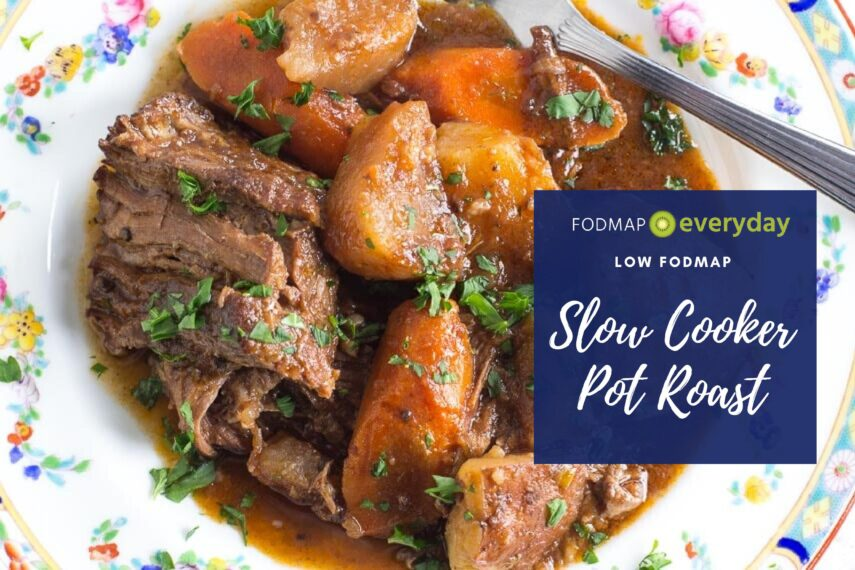 slow cooker pot roast, plated on a decorative floral plate