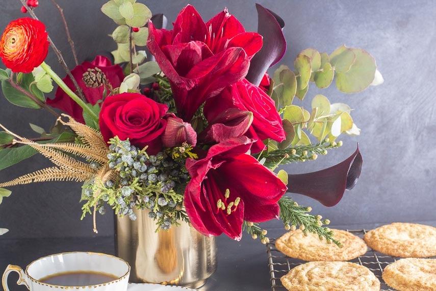 Low FODMAP Snickerdoodles on rack in background; red flower arrangement