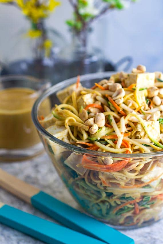 Low FODMAP Zoodles, Noodles & Sprouts Salad in clear glass bowl